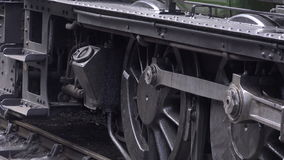 B&W Shot of steam train wheels coming to a stop 4K. Steam train wheels filmed black and white but in 4K stock footage