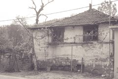 B&W Simple old and abandoned house. Simple old and abandoned house made of mud, straw and stone, monochrome Royalty Free Stock Photos