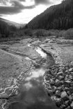 B&W of small mountain stream. Stock Photos