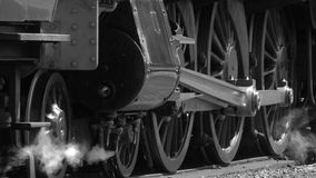 B&W Steam engine wheels move slowly on tracks 4K stock video footage