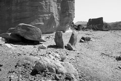 B&W stone desert rocks and cliffs. Black and white stone desert huge rocks and cliffs inside deep canyon gorge, Negev desert, Israel Stock Images