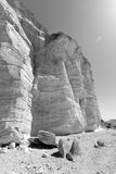 B&W stone desert rocks and cliffs. Black and white stone desert huge rocks and cliffs inside deep canyon gorge, Negev desert, Israel Royalty Free Stock Photography