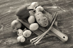 B&W of veggies and cutting board. Stock Images