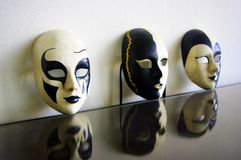 B&w venetian masks. Black and white venetian masks with reflection Royalty Free Stock Images