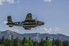 B25 Warbird making low pass over Big Bear City, California royalty free stock photo
