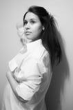 B&white model posing. Closeup of beautiful young woman in white shirt stock photography