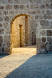 B163 Arad Fort. Stone arch and light at Qal'at 'Arad fort on the north side of Bahrain Royalty Free Stock Photography