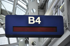 B4 Airport Gate Sign. A dark blue airport B4 gate sign Stock Images