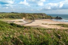 Baía de três penhascos, Swansea, Reino Unido Fotografia de Stock Royalty Free