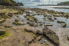 Baía de três penhascos, Swansea, Reino Unido Imagens de Stock