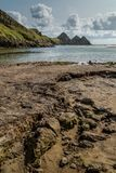 Baía de três penhascos, Swansea, Reino Unido Fotos de Stock