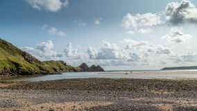 Baía de três penhascos, Swansea, Reino Unido Imagem de Stock