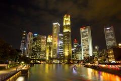 BAÍA do PORTO, SINGAPURA 16 de março: Construção do negócio em Marina Bay a Imagens de Stock