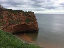 Baía vermelha Devon do ladram da rocha Fotos de Stock