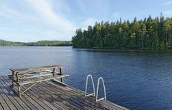 Baño del embarcadero en el lago Imagen de archivo libre de regalías