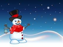 Bałwan jest ubranym kapelusz, czerwonego pulower i czerwonego szalika z z lampionem, gwiazdy, nieba i śniegu wzgórza tłem dla twó Obraz Royalty Free