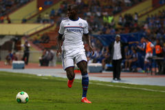 Ba demba. SHAH ALAM - JULY 21: Chelsea Football Club player Demba Ba (white jersey) controls the ball in a friendly match with the Malaysian national team in Stock Photo