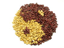 Ba-gua lentil. Chines traditional ba-gua sign made by lentils. It is an Yin-Yang symbol, red lentils represent Yang , yellow lentils are Yin. Yin-yang in Chines Stock Photos