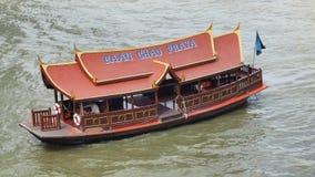 Baan Chao Praya shuttle boat cruises on the river. BANGKOK, THAILAND - JANUARY 7, 2018:  High rise condominium Baan Chao Praya shuttle boat cruises on Chao Praya Stock Image