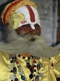 BABA. A saint indisplaying his moustache in Pashupatinath Temple during 'Maha Shivaratri' festival in Kathmandu,Nepal Stock Photography