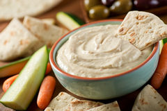 Baba Ganoush. A bowl of delicious homemade baba ganoush dip with pita, carrots, cucumber, zucchini, and olives Royalty Free Stock Photography