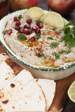 Baba ghanoush, levantine eggplant dip. Baba ghanoush, levantine eggplant dish with lemon and pomegranate seeds Stock Photo