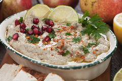 Baba ghanoush, levantine eggplant dip. Baba ghanoush, levantine eggplant dish with lemon and pomegranate seeds Royalty Free Stock Images