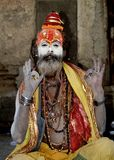 Baba with a pose. A baba posing for photograph during Maha Shivaratri festival in Pashupatinath Temple, Kathmandu,Nepal Stock Image
