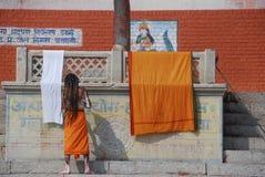 Baba in Varanasi. A baba taking a shower in Varanasi Ghat Royalty Free Stock Image