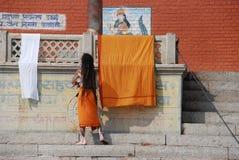 Baba in Varanasi. A baba taking a shower in Varanasi Ghat Royalty Free Stock Photo