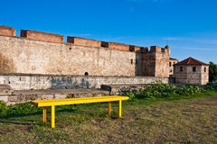 Baba Vida Fortress. Bench on the lawn in front of Baba Vida Castle in Vidin, Bulgaria Royalty Free Stock Photo