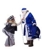 Baba Yaga och faderjul Royaltyfria Bilder