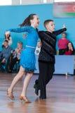 Babaev Daniel en Butkevich Polina Perform jeugd-1 Latijns-Amerikaans Programma Stock Afbeeldingen