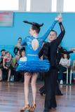 Babaev Daniel en Butkevich Polina Perform jeugd-1 Latijns-Amerikaans Programma Stock Foto's