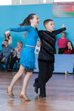 Babaev Daniel och Butkevich Polina Perform Juvenile-1 latin - amerikanskt program Arkivbilder