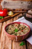 Babaganoush with tomatoes, cucumber and parsley - arabian eggplant dish or salad on wooden background. Selective focus Royalty Free Stock Images