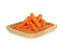 Babay carrots in wooden plate on white background Royalty Free Stock Photo