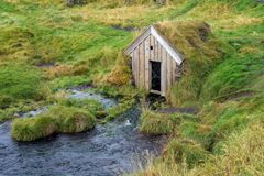 Babbling Brook House. A house like structure that is being used to cover the origin of a spring fed stream stock image