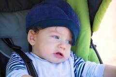Babby boy in stroller Stock Image