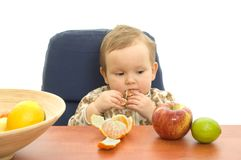 Babby eat fruit Stock Photos