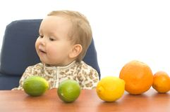 Babby and fruits Royalty Free Stock Images