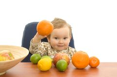 Babby and fruits Stock Photos