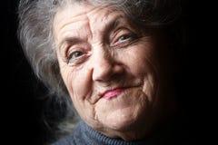 Babci twarz na czarnym tle Zdjęcia Stock
