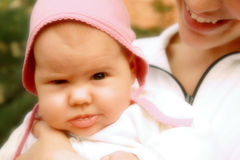 Babe. Charming baby in mother's hands Royalty Free Stock Images