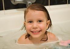 The babe bathes. In a bathroom stock photos