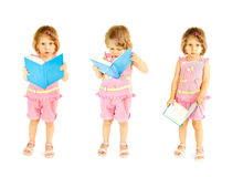 The babe with the book. A white background royalty free stock photo