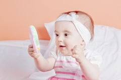 Babe girl playing with a toy surprise. Stock Images