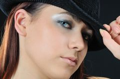 Babe in hat. Babe in black hat and hold on the her two fingers stock image