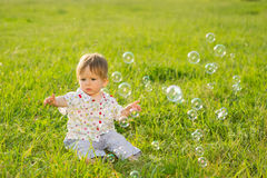 Babe on the lawn. Royalty Free Stock Photo