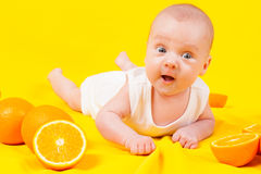 Babe lies in oranges Royalty Free Stock Photo